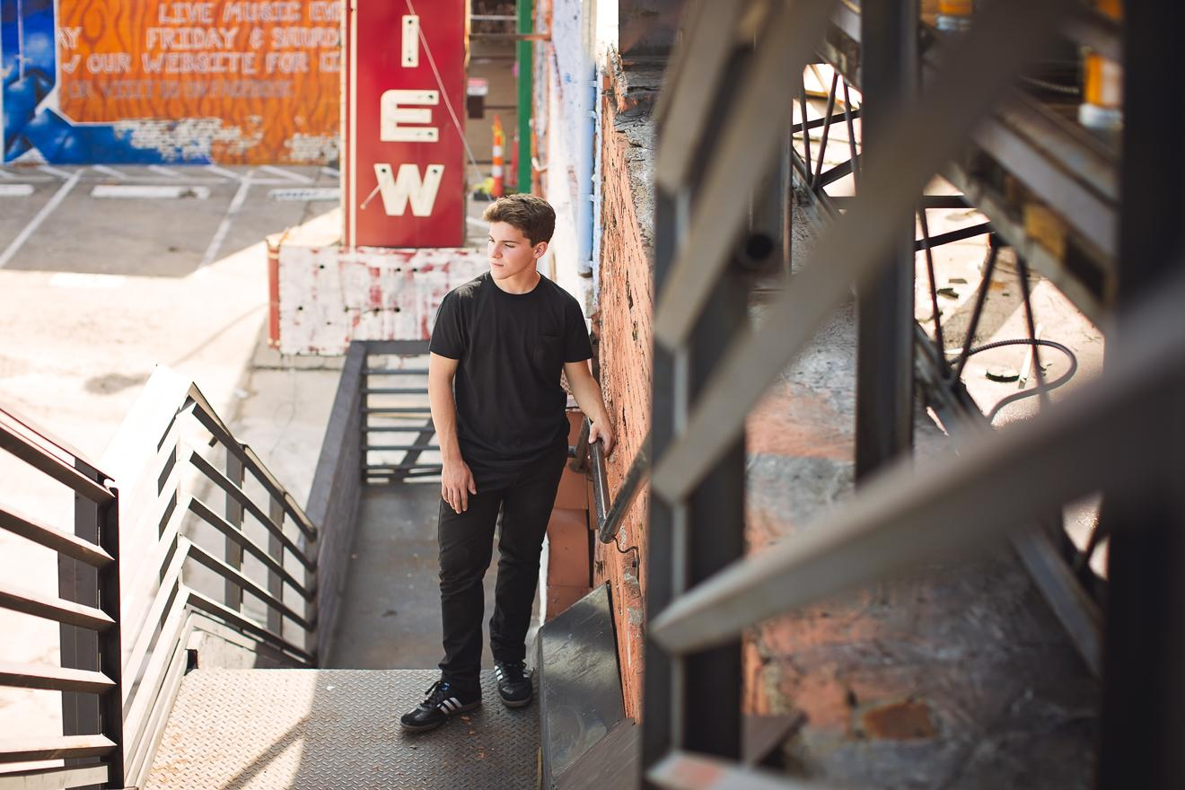 Graduating senior session boy guy in Deep Ellum by Sunny Mays Photography