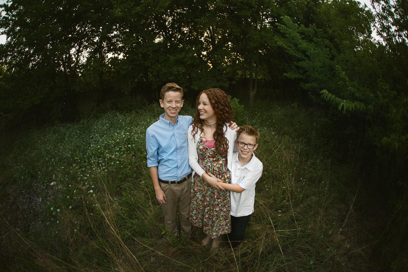 Tween siblings in a field in Southlake Trophy Club Keller by Sunny Mays