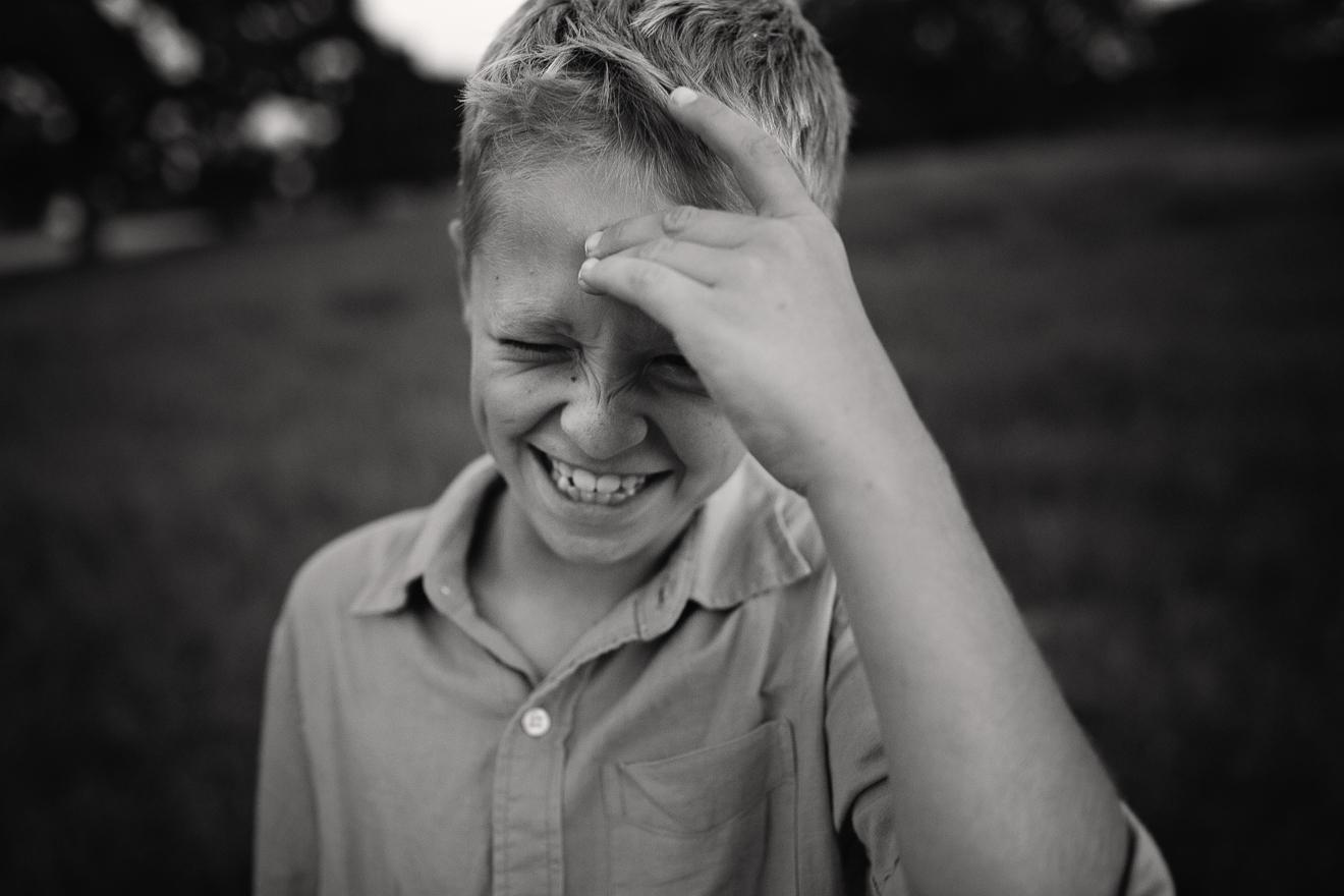 tween boy laughing best tween lifestyle photographer in Dallas Ft. Worth by Sunny Mays